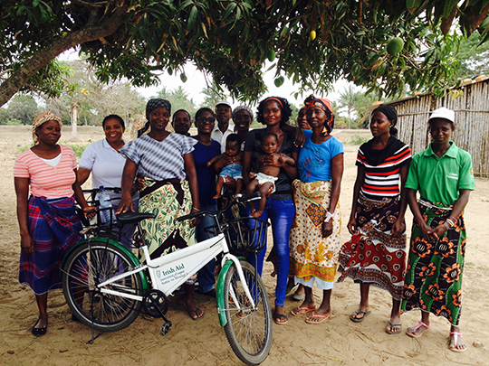 Monitoring visit. Members of Govuro Home based care association, IA staff member, and Provincial Directorate of Health staff member. Members with a bicycle that was donated by Irish Aid. Govuro, Inhambane Province Nov 2015. Credit: Irish Aid