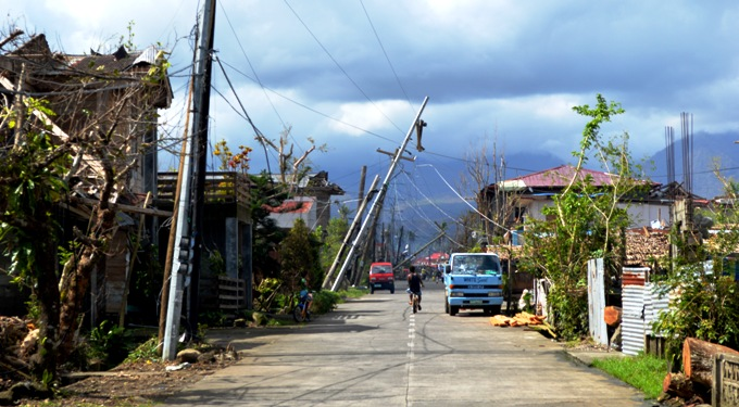 Electricity poles and cables which were damaged by Typhoon Haiyan line a street in Jaro, Leyte provence. Photo: Irish Aid