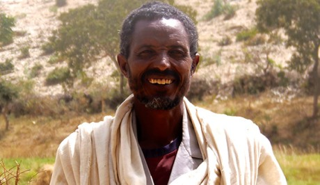 GebreMariam Desalegn stands on his farm in Tigray, Northern Ethiopia.
