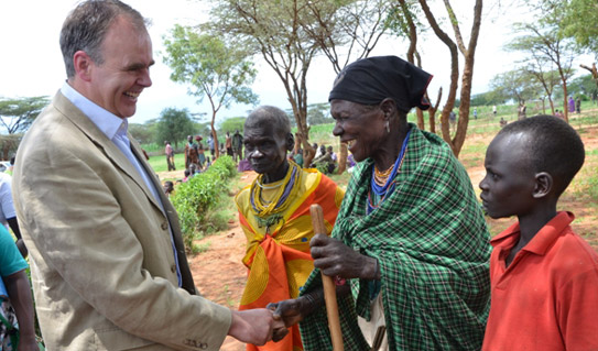 Minister Mc Hugh meets sage recipient with grandchild during his visit to Uganda