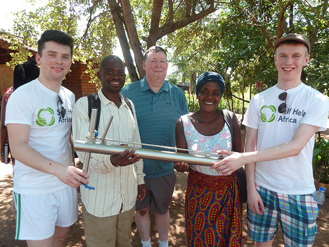 Diarmuid Curtin (left), teacher Donal Enright (center) and Jack O'Connor (right) with farmers Memory Pemba and Alick Bamusse in Kwitanda village, Balaka. Credit: Gorta Self Help Africa